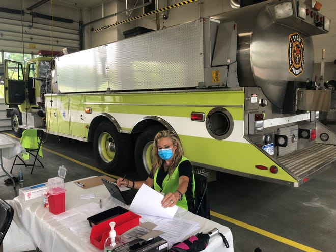 Dawn Ransdell, senior public health sanitarian for the Oakland County Health Division, awaits takers for the COVID-19 vaccination during a walk-in clinic at Lyon Township Fire Station #2 on June 25, 2021.
