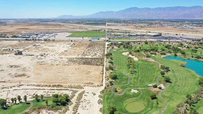 The empty land on the left, seen here on June 25, 2021, was once pitched as the future home of an Aztec theme park. On the right is Eagle Falls Golf Course.