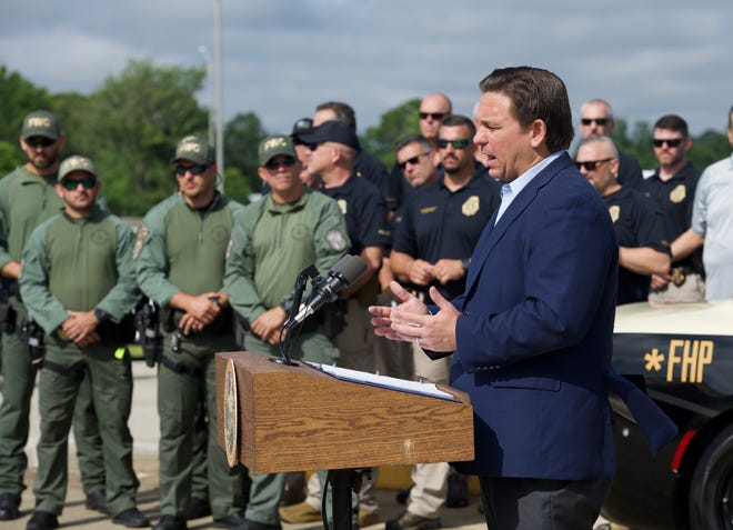 Gov. Ron DeSantis announced 50 state law enforcement officers are deploying to the U.S. southern border to assist Texas and Arizona during a press conference June 25, held at an Interstate 10 weigh station near the Florida-Alabama state line in Pensacola.