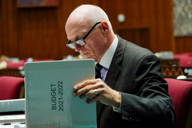 House Speaker Rusty Bowers, R-Mesa, looks over the printed budget prior to a vote on it at the Arizona Capitol on Thursday, June 24, 2021.