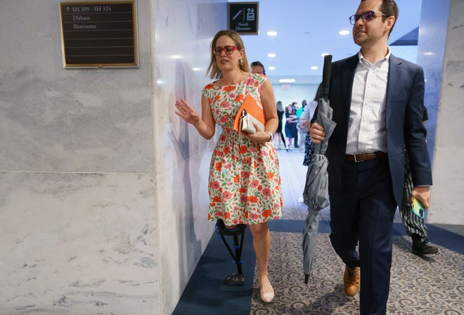 Sen. Kyrsten Sinema leaves a closed-door meeting on Capitol Hill with other Democrats in the bipartisan talks, in Washington, Tuesday, June 22, 2021.