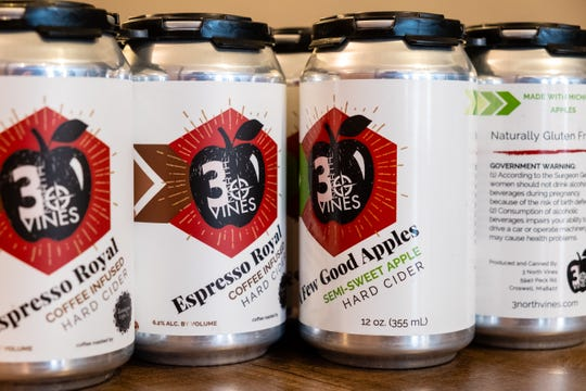 Cans of cider made by 3 North Vines arranged on the bar at 3 North Lexington.