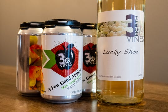 Cans of cider and a bottle of wine made by 3 North Vines are arranged on the bar at 3 North Lexington.
