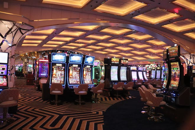 Slot machines on the casino floor of Resorts World Las Vegas, which opened to the public on June 24, 2021.