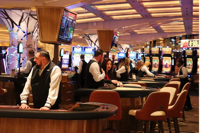 Dealers wait for visitors at Resorts World Las Vegas, which opened to the public on June 24, 2021.