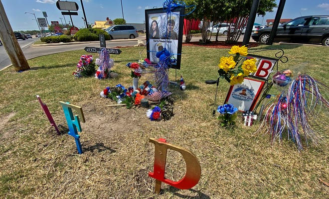 A memorial for Donaven Byers, 16, Alexis Sorrola-Villamil, 17, and Fabian Sanchez, 12, is seen here in this Friday, June 25, 2021 photo. It stands at the corner of South Bryant Boulevard and Avenue N where the accident that killed them occurred.