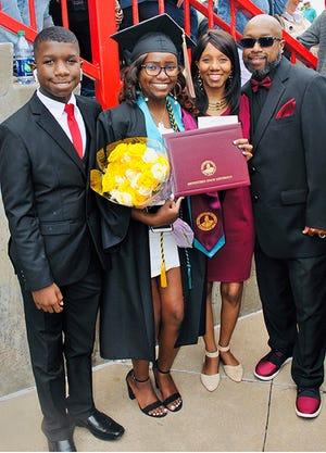 Kari Bell with family members at her 2019 graduation.