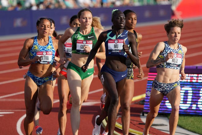 Athing Mu, second from right, leads a women's 800-meter heat during the US Olympic track and field trials on June 24.