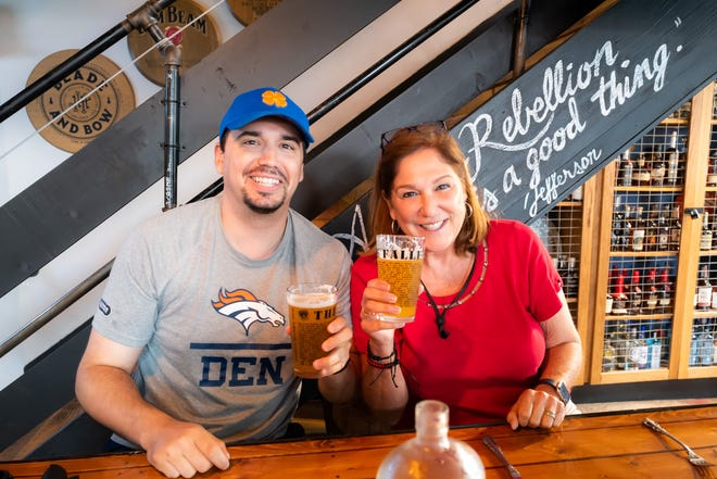Alejandro Rodriguez, 40, (left) and his mom, Elena Blasser, 64, pose for a photo at a brewery in Washington, D.C., during a family vacation in June. Blasser is unaccounted for after a 12-story oceanside Miami condo plummeted early Thursday.