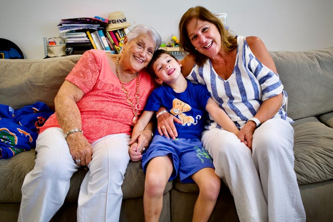 Elena Chavez (88) (left) and Elena Blasser (64) (right) pose with their grandson and great-grandson John Paul.  Chavez and Blesser have yet to be found after a 12-story Miami apartment collapsed early Thursday.