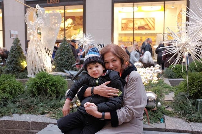 Elena Blasser, 64, poses for a photo with her grandson, John Paul, in New York City.