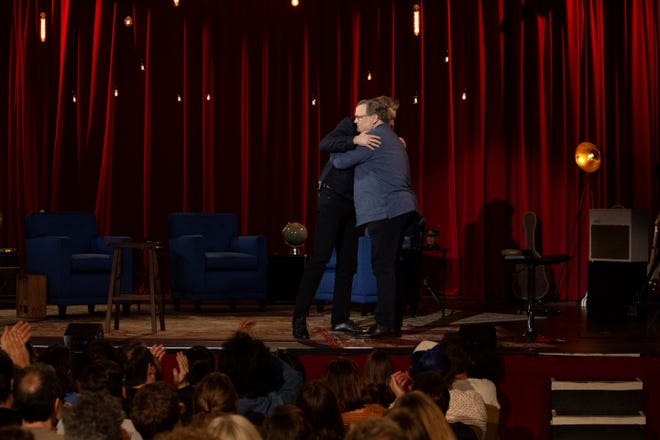 """""""Conan"""" sidekick Andy Richter, foreground, and host Conan O'Brien share an emotional hug during the June 24 finale of the TBS late-night talk show."""