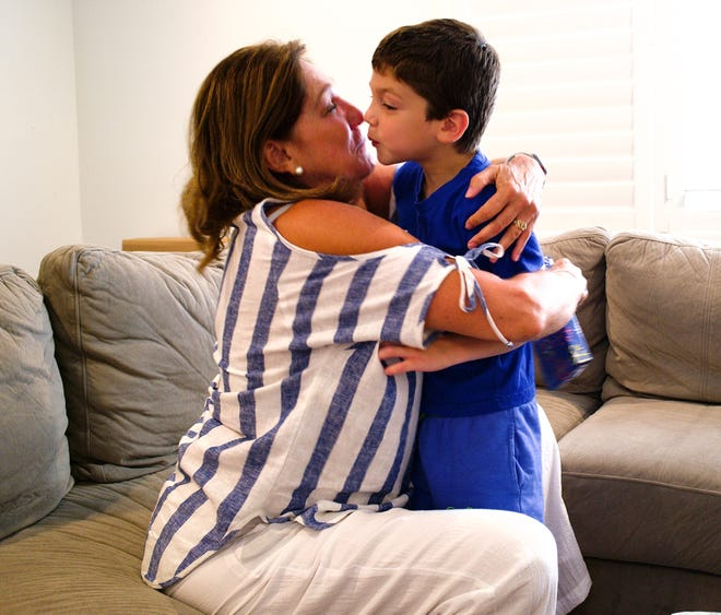 Elena Blasser, 64, and her grandson, John Paul, kiss hello during one of their many Saturday dates.