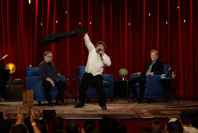 """Despite a sprained ankle, Jack Black, center, went all out during a """"My Way"""" tribute to Conan O'Brien, titled """"Cones Way,"""" on the finale of TBS' """"Conan"""" on June 24. O'Brien, right, and sidekick Andy Richter watch."""