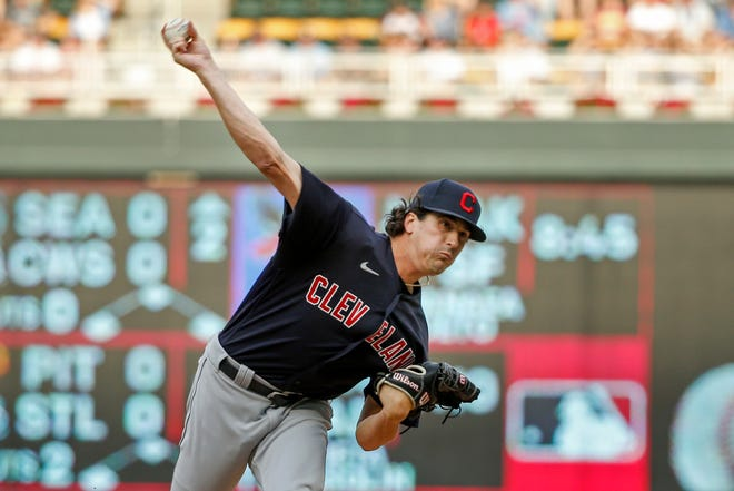 Cleveland's Cal Quantrill throws to the Minnesota Twins in the first inning of a baseball game Friday, June 25, 2021, in Minneapolis. (AP Photo/Bruce Kluckhohn)