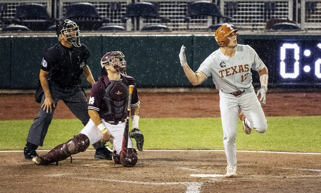 """Texas' Ivan Melendez flips his bat as he, Mississippi State catcher Logan Tanner and the home plate umpire watch his three-run home run leave TD Ameritrade Park in the ninth inning. """"I knew when it came off his bat it was gone,"""" Texas coach David Pierce said.""""He absolutely hammered that pitch."""""""