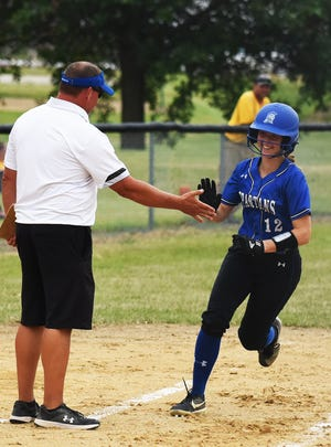 Collins-Maxwell catcher Marissa Boege is all smiles as she's congratulated by head coach Troy Houge after hitting a solo home run in the Spartans' 10-0 victory over GMG Friday at Collins. Boege has provided outstanding play to help the Spartans off to an 18-1 start and No. 3 ranking in Class 1A.