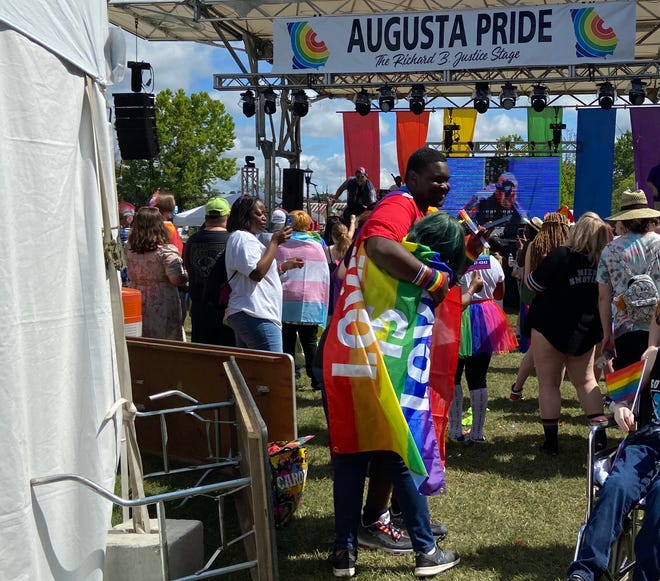 Xavian Bradshaw (left) and Pax Craig (right) embrace at the Augusta Pride Festival at the Augusta Common on Saturday morning, June 26, 2021.