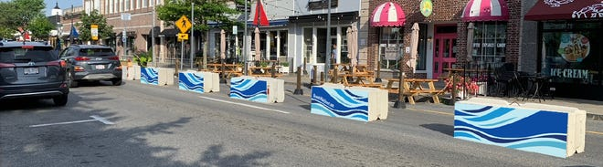 Cement barriers on Hyannis Main Street provide for expanded outdoor dining and pedestrian access. The Town of Barnstable is recruiting volunteers to survey residents and visitors on how they feel about the summertime redesign.