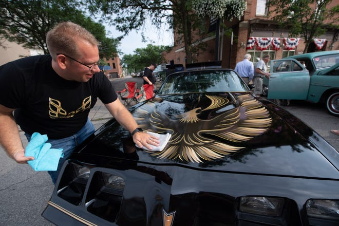 Mike Woodruff of Wooster cares for his 1980 Trans Am during the Main Street Concert & Cruise-In in June. The August car show and music event will be held 6:30-9 p.m. Friday.