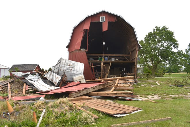 This barn on the property of Brian and Kaye Bowman, along Cemetery Road in Riga Township, was one of the most heavily damaged structures from last week's tornado that passed through Riga Township from 9:23 to 9:27 p.m. Residents in the township have been picking up the pieces from Sunday's tornado, the first to hit Lenawee County in more than 11 years.