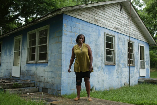 Vice Mayor Jacqueline A.W. Granberry stands in front of her childhood home on Scotts Mill Road in Mt. Pleasant, Tenn., on Friday, June 25, 2021.