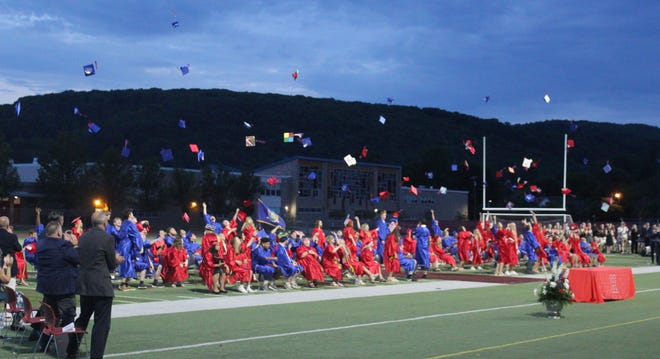 The Hornell High School Class of 2021 tosses their caps in the air as they officially become graduates.