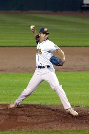 Burlington Bees' relief pitcher Reece Wissinger came in with bases loaded in the sixth inning then struck out three batters against the Springfield Sliders Friday at Community Field in Burlington.