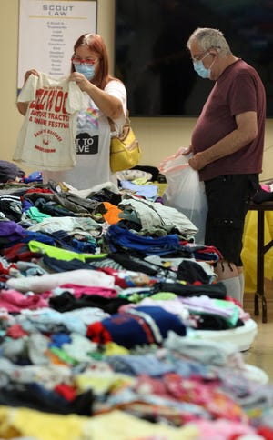 William Moore and Anita Powell shop together during the Lawndale Baptist Church clothing giveaway held Saturday morning, June 26, 2021 at the church in Lawndale.