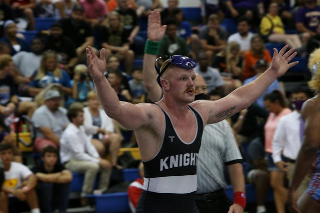 North Henderson graduate Triston Norris celebrates his first-ever state title at Saturday's 3-A wrestling state championship at Eastern Guilford High School in Gibsonville.
