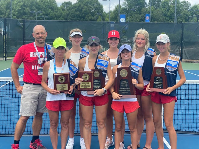 Hendersonville's girls team, including the doubles state championship duo of McCollough Perry (center) and Eliza Perry, far right, pose after Saturday's 2-A state championship finals in Cary.