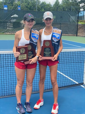 Hendersonville's McCollough Perry, left, and Eliza Perry pose after winning the 2-A double state title on Saturday at Cary Tennis Park.