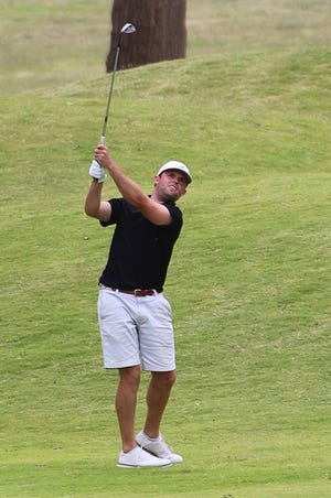 Alex Ellis hits his approach into the No. 9 green during Saturday's second round of the Hillcrest Swinger. Ellis and playing partner Cory Bull shot 15-under-par 57 in the two-man low-ball.