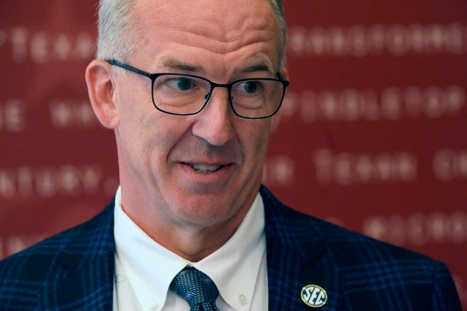 Greg Sankey, commissioner of the Southeastern Conference, smiles as he speaks to reporters after the College Football Playoff meeting on Tuesday in Grapevine, Texas.