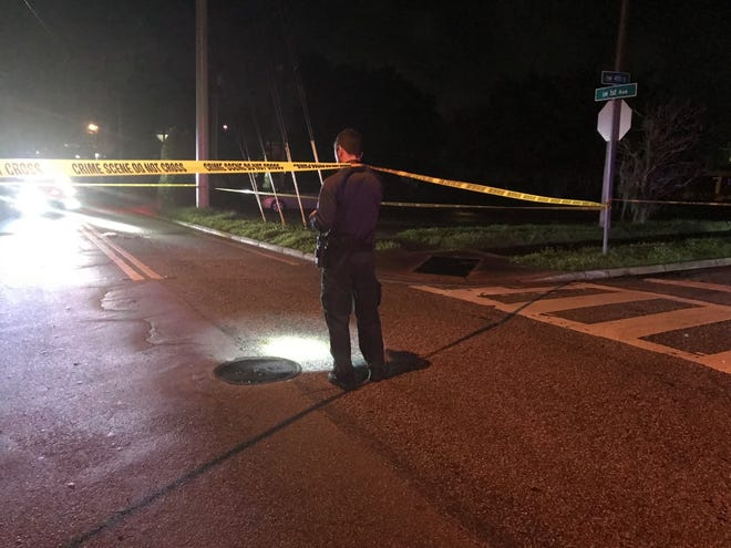 An Ocala Police Department evidence officer examines the scene at a fatal crash.