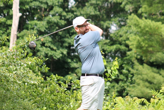 Aaron Connolly follows through on his drive during the second round of the Seacoast Am golf tournament Saturday at Breakfast Hill Golf Club in Greenland. Connolly and former Seacoast Am champ Mike Mahan are tied for fifth at 151, four shots off the pace.
