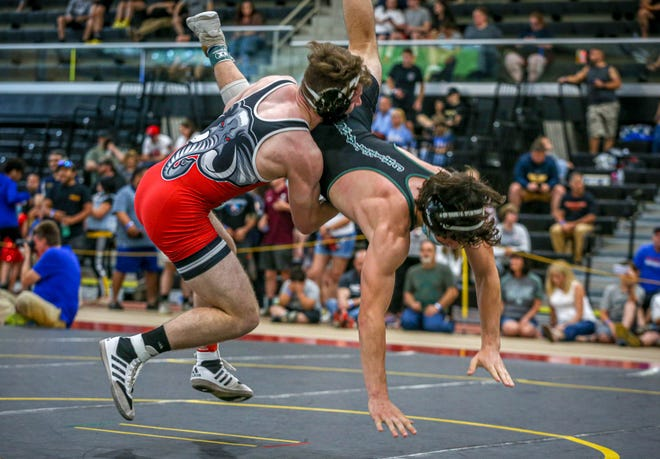 Coventry's Christian Rutherford attempts a takedown during his semifinal match against Ponaganset's Nicholas Baccala.