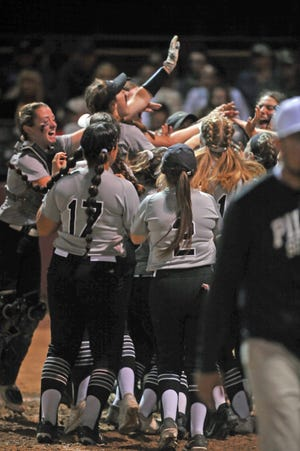 The Pilgrim softball team mobs Alyssa Twomey after her home run against Coventry on Friday night.