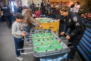 Adrian Lopez plays foosball with Stockton Police Sgt. Anabel Morris during the Stockton Police Department's Cotton Candy Social Jan. 24, 2020, at the Teen Impact Center in downtown Stockton.