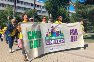 Child-care providers, including from left, Justine Flores, Sylvia Hernandez, Rasiene Reece and Zoila Toma, rally at the Capitol in Sacramento on Thursday to push for Gov. Gavin Newsom and state legislative leaders to raise their pay through the state budget.
