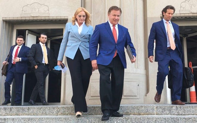 Patricia McCloskey, left, and her husband Mark McCloskey walk out of the Carnahan Courthouse in downtown St. Louis on Thursday, June 17, 2021, with their lawyer Joel Schwartz, right. The St. Louis couple who gained notoriety for pointing guns at social justice demonstrators last year pleaded guilty Thursday to misdemeanor charges and agreed to give up the weapons they used during the confrontation. Joel Currier/St. Louis Post-Dispatch via AP