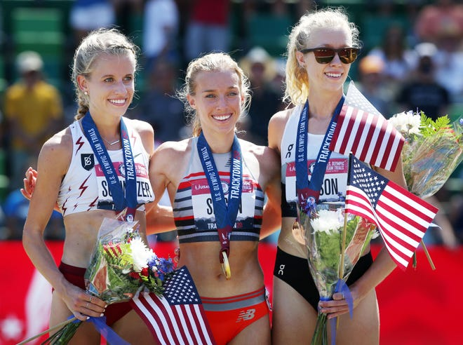 Emily Sisson, center, celebrates her win in the women's 10,000 meters at the U.S. Olympic Track & Field Trials on Saturday with Karissa Schweizer, left, who finished second, and Alicia Monson, who was third. The event was moved up to Saturday morning at Hayward Field because of the projected triple-digit temperatures for later in the day.