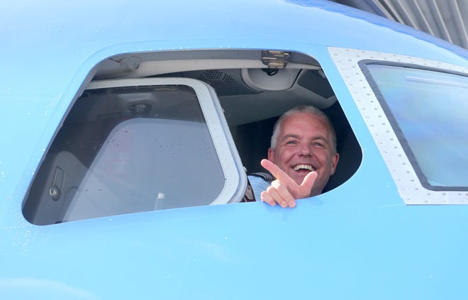 A Breeze Airways crew member looks out the window after their first flight into the Akron-Canton Airport in Green on Saturday, June 26, 2021.