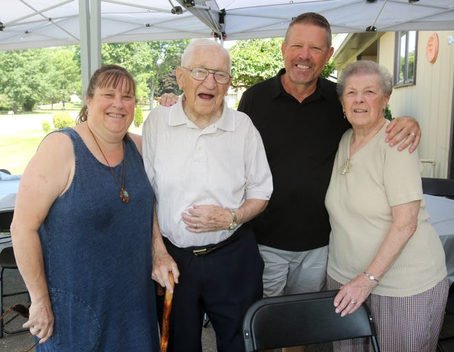 Albert, second from left, and Patricia Prazniak, far right, are shown Saturday with two of their five children, Jane Harper and Mark Prazniak, at their parents' home in Jackson Township. The couple will celebrate their 70th wedding anniversary on Wednesday.