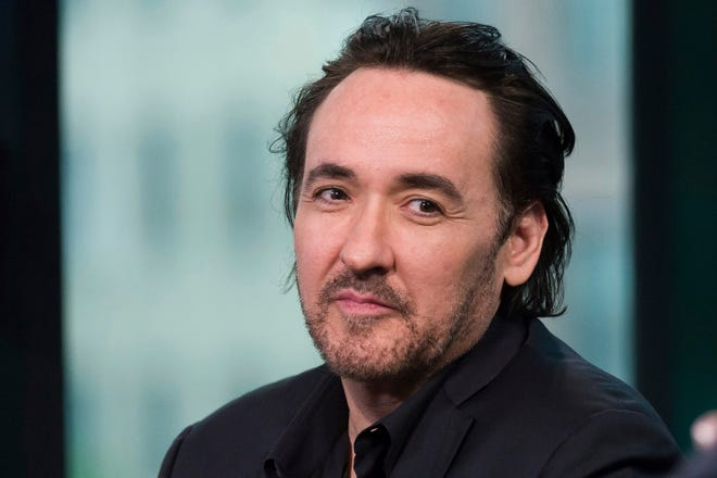 """In this June 4, 2015 photo, actor John Cusack participates in AOL's BUILD Speaker Series to discuss the film """"Love & Mercy"""" in New York. Cusack was born in Evanston, Illinois, on June 28, 1966."""