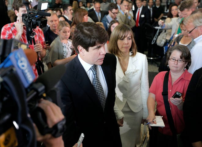 Former Illinois Gov. Rod Blagojevich prepares to speak to the media with his wife, Patti, on June 27, 2011, at the federal courthouse in Chicago. Blagojevich that day was convicted by a jury on a wide range of corruption charges, including the allegation that he'd tried to sell or trade President Barack Obama's U.S. Senate seat.