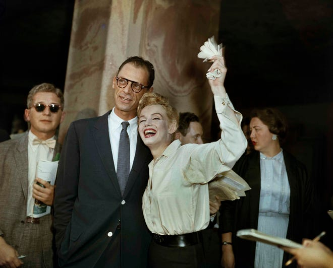 Newlyweds Arthur Miller, center, and Marilyn Monroe are shown after their civil wedding ceremony in White Plains, New York on June 29, 1956.