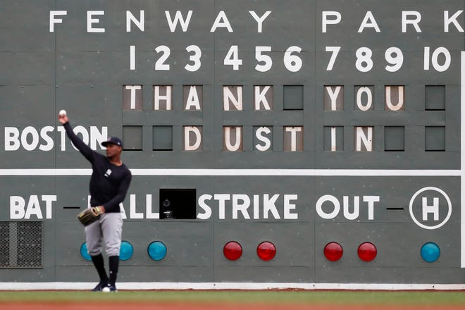 A message on the left field scoreboard pays tribute to former Boston Red Sox's Dustin Pedroia, who was honored before Friday's game against the New York Yankees.