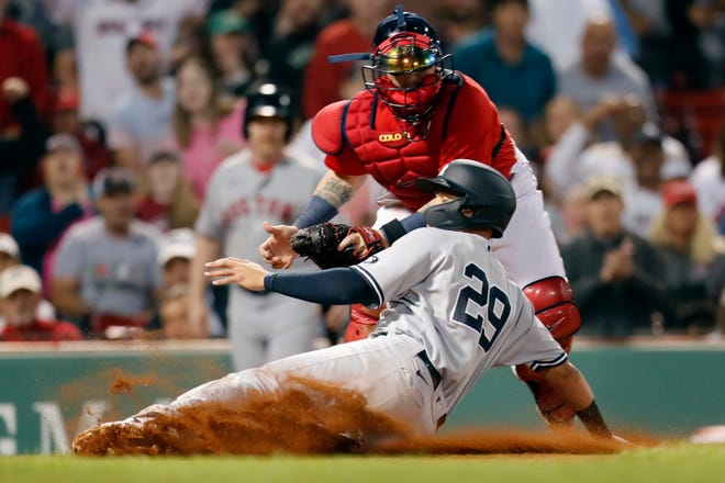 Boston Red Sox's Christian Vazquez tags New York Yankees' Gio Urshela (29) during the Red Sox's win Friday at Fenway Park.