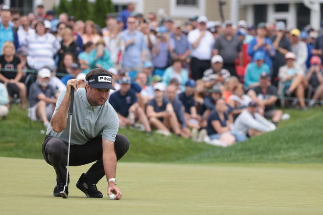 Bubba Watson lines up his putt on the 9th green during the second round of the Travelers Championship golf tournament.